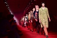 Models present creations for fashion house Gucci during the Men Fall - Winter 2016 / 2017 collection shows at the Milan's Fashion Week on January 18, 2016 in Milan. AFP PHOTO / GIUSEPPE CACACE / AFP / GIUSEPPE CACACE (Photo credit should read GIUSEPPE CACACE/AFP/Getty Images)